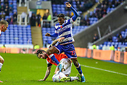 Luton Town midfielder Jacob Butterfield (29) tackles Reading defender Omar Richards (27) during the EFL Sky Bet Championship match between Reading and Luton Town at the Madejski Stadium, Reading, England on 9 November 2019.