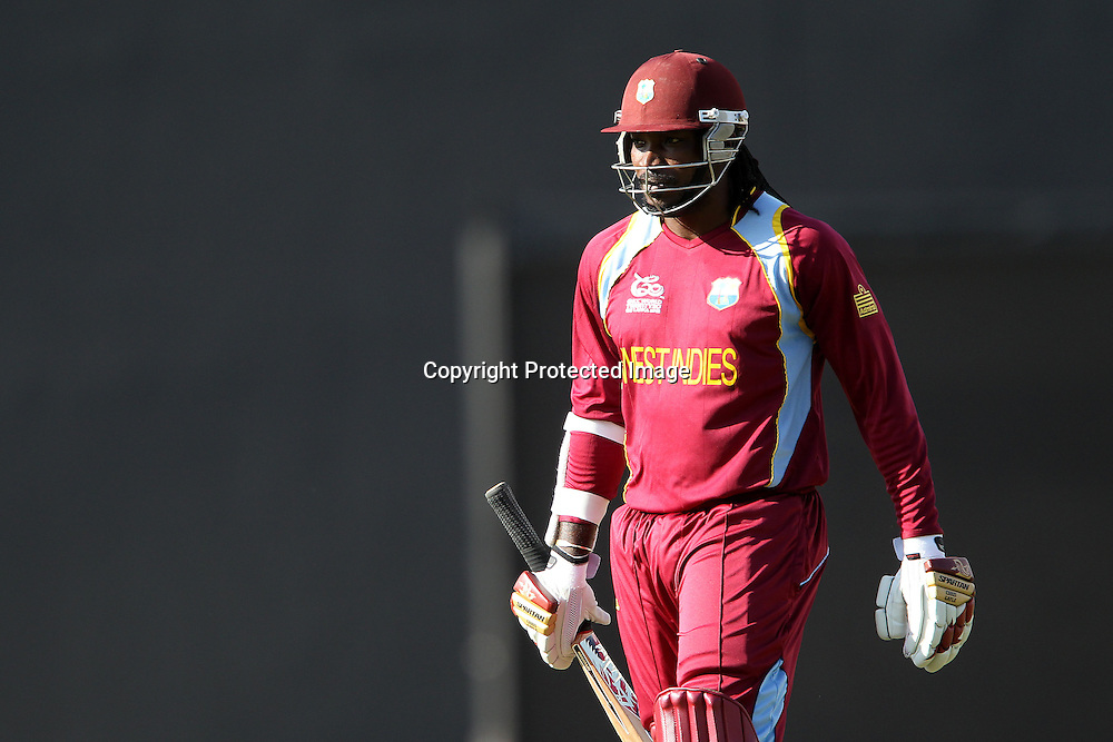 Chris Gayle of The West Indies departs during the ICC World Twenty20 Super Eights match between The West Indies and New Zealand held at the  Pallekele Stadium in Kandy, Sri Lanka on the 1st October 2012<br /> <br /> Photo by Ron Gaunt/SPORTZPICS/PHOTOSPORT