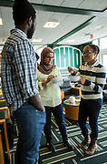 Ohio University students (from left to right) Papa Ndiaye, from Senegal, Samar Alwabel, from Saudi Arabia, and Ariana Bovell enjoy their ice cream and pleasant conversation at the International Student Union's Global Scoop event at Baker University Center on Tuesday afternoon, April 15, 2014.