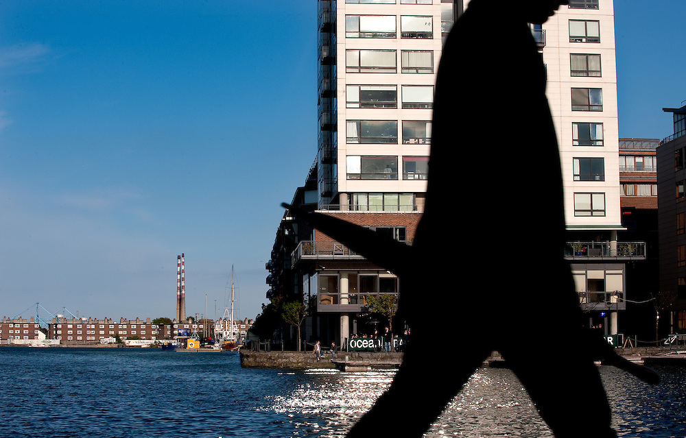 Man walks past the Ocean bar, a popular after-work bar in the Grand Canal area of Dublin's regenerated Docklands area.