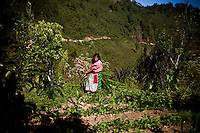 A woman in a remote village outside of Uspantan, Guatemala, on March 28, 2012. Many indigenous Guatemalans were accused by the government of harboring leftist guerrillas. Villagers here fled to the mountains where they lived for 12 years when the military came and burned their homes, raped the women and forced men into civic patrols.