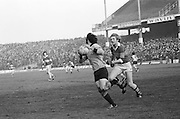 Kerry chases down the Dublin player in possession of the ball during the All Ireland Senior Gaelic Football Semi Final, Dublin v Kerry in Croke Park on the 23rd of January 1977. Dublin 3-12 Kerry 1-13.
