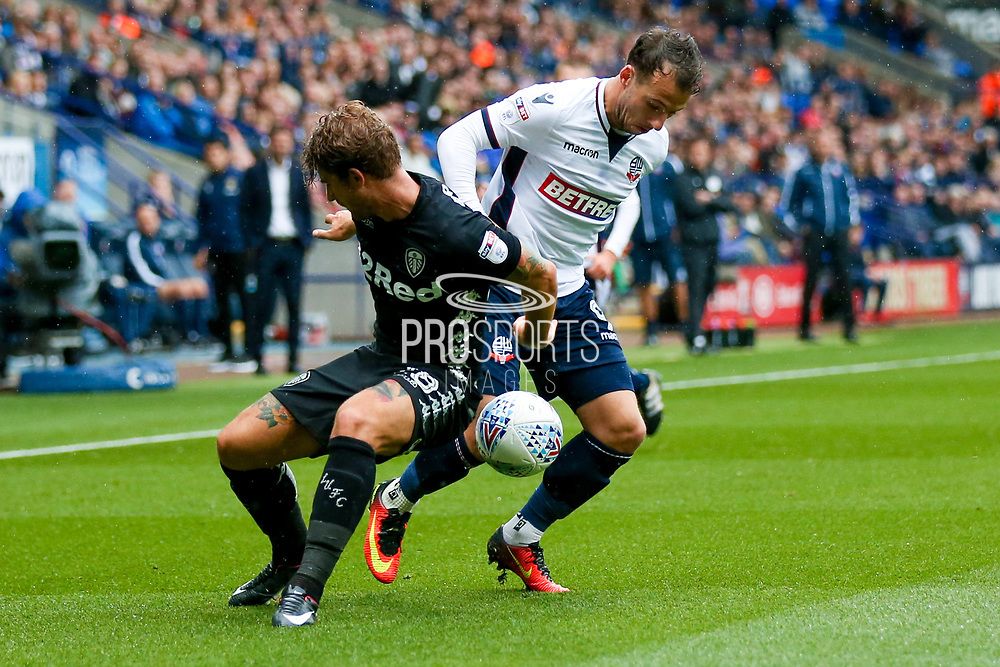 Leeds United defender Gaetano Berardi (28) is beaten by Bolton Wanderers forward Adam Le Fondre (9)  during the EFL Sky Bet Championship match between Bolton Wanderers and Leeds United at the Macron Stadium, Bolton, England on 6 August 2017. Photo by Simon Davies.