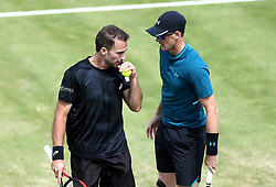 Great Britain's Jamie Murray (right) and Brazil's Bruno Soares (left) during day four of the Fever-Tree Championship at the Queen's Club, London. PRESS ASSOCIATION Photo. Picture date: Thursday June 21, 2018. See PA story TENNIS Queens. Photo credit should read: Steven Paston/PA Wire. RESTRICTIONS: Editorial use only, no commercial use without prior permission.