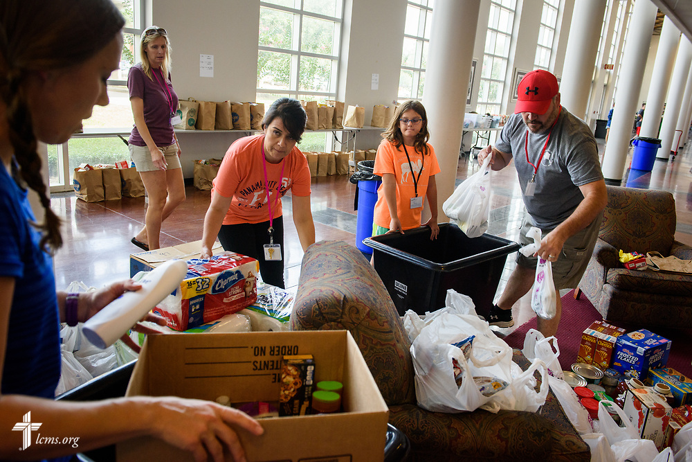 (L-R) Volunteers at Trinity Klein Lutheran Church, Spring, Texas, including (L-R) Rachel Hill, Joanna Stanley, Rosy Martinez, Karsen Martin and her father Butch Martin drop off and organize supplies for Hurricane Harvey victims at the church on Saturday, Sept. 2, 2017. LCMS Communications/Erik M. Lunsford