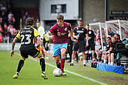 Scunthorpe United's Connor Townsend(3) takes on Rotherham United midfielder Ryan Williams (23) during the EFL Sky Bet League 1 match between Scunthorpe United and Rotherham United at Glanford Park, Scunthorpe, England on 12 May 2018. Picture by Nigel Cole.