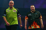 Michael van Gerwen and Ryan Joyce during the World Darts Championships 2018 at Alexandra Palace, London, United Kingdom on 29 December 2018.