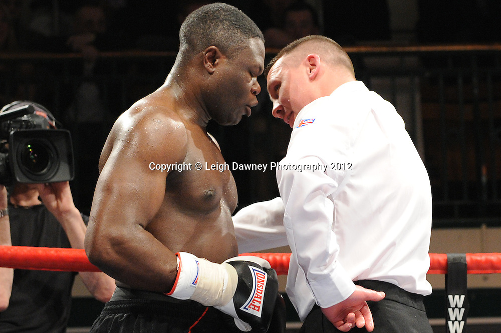 Wadi Camacho defeats  Moses Matovu (in discussion with referee) in a 4x3min Cruiserweight contest at York Hall, Bethnal Green, London on 28th January 2012.Matchroom Sport. © Leigh Dawney Photography 2012.