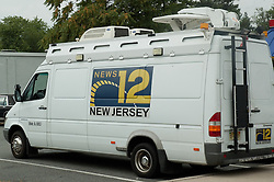 The News 12 team is positined in the makeshift media lot previously known as Burger King.