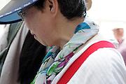 Asian woman with sun cap