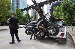 "A police officer stands by as a tow truck operator removes a motorcycle from the scene after a female stunt driver working on the movie ""Deadpool 2"" died after a crash on set, in Vancouver, BC, Canada, on Monday August 14, 2017. Vancouver police say the driver was on a motorcycle when the crash occurred on the movie set on Monday morning. Photo by Darryl Dyck/CP/ABACAPRESS.COM"
