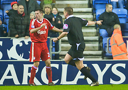 WIGAN, ENGLAND - Wednesday, January 28, 2009: Referee Phil Dowd points to the spot to award Wigan Athletic a late penalty and the opportunity to make the score 1-1 during the Premiership match against Liverpool at the JJB Stadium. (Mandatory credit: David Rawcliffe/Propaganda)