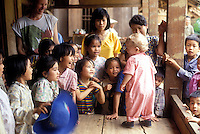 young western boy meeting new vietnamese friends
