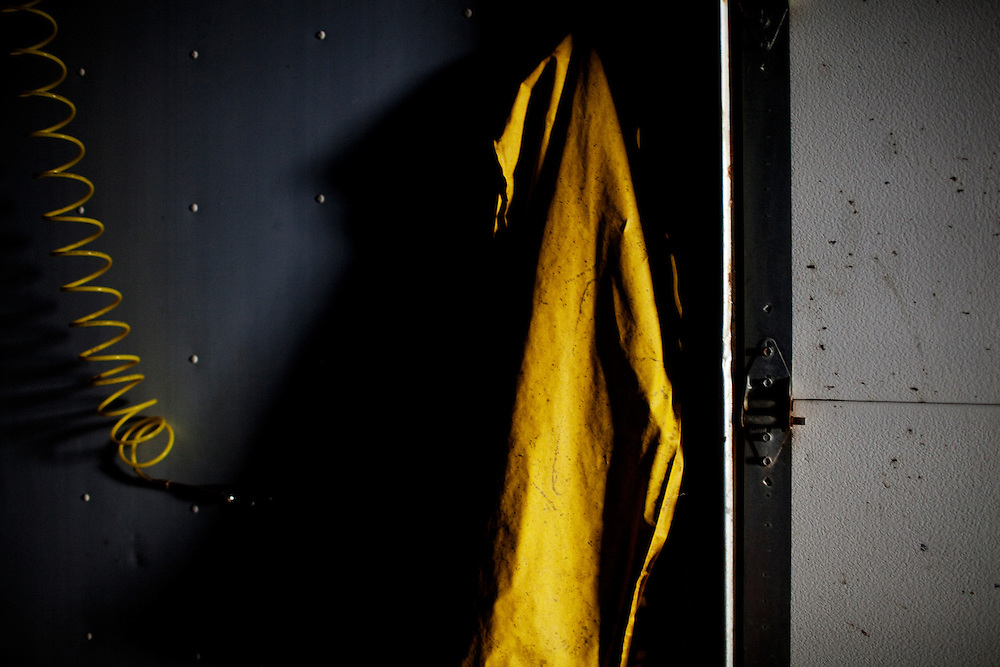 A jacket hangs in one of the rooms where the gators are skinned and cleaned at Daneco Alligator Farm in Houma, Louisiana on Thursday, February 18, 2010.
