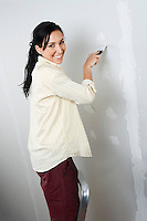 Woman Spackling Wall