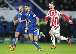 Riyad Mahrez of Leicester City (L) and Glenn Whelan of Stoke City in action - Mandatory byline: Jack Phillips/JMP - 23/01/2016 - FOOTBALL - King Power Stadium - Leicester, England - Leicester City v Stoke City - Barclays Premier League