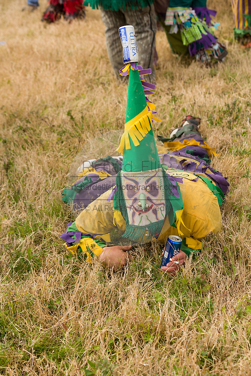 A costumed reveler begs for food during the Mamou Courir de Mardi Gras chicken run on Fat Tuesday February 17, 2015 in Mamou, Louisiana. The traditional Cajun Mardi Gras involves costumed revelers competing to catch a live chicken as they move from house to house throughout the rural community.