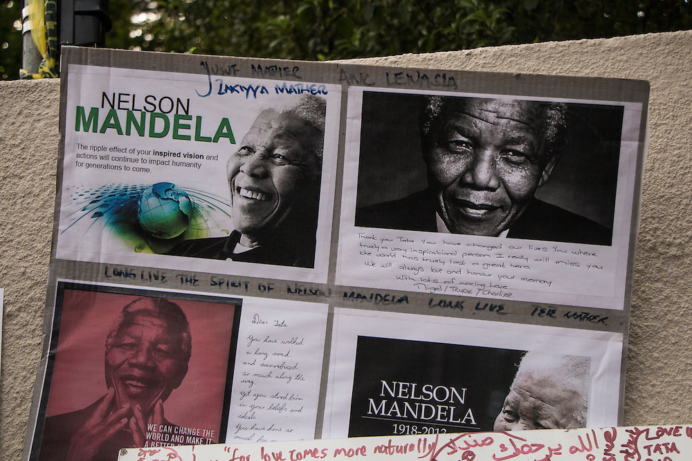 A memorial dropped off outside Nelson Mandela's house in Johannesburg, on Saturday Dec.7 2013.