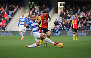 Queens Park Rangers midfielder, Karl Henry (20) tackling Birmingham City midfielder, Jon Toral (20) during the Sky Bet Championship match between Queens Park Rangers and Birmingham City at the Loftus Road Stadium, London, England on 27 February 2016. Photo by Matthew Redman.