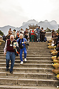 CHINA, SANDOUPING:  Vendors selling fresh fruit, souvenirs and books about the Three Gorges Dam to tourists from the cruise ships that stop at Sandouping and the Three Gorges Dam during a Yangtze River Cruise. Photo Illustration.
