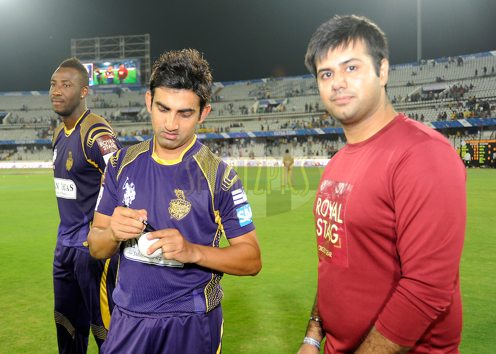 Gautam Gambhir captain of Kolkata Knight Riders signs the ball for Royal stag fan of the match during match 1 of the Oppo Champions League Twenty20 between the Kolkata Knight Riders and the Chennai Superkings held at the Rajiv Gandhi Cricket Stadium, Hyderabad, India on the 17th September 2014<br /> <br /> Photo by:  Pal Pillai / Sportzpics/ CLT20<br /> <br /> <br /> Image use is subject to the terms and conditions as laid out by the BCCI/ CLT20.  The terms and conditions can be downloaded here:<br /> <br /> http://sportzpics.photoshelter.com/gallery/CLT20-Image-Terms-and-Conditions-2014/G0000IfNJn535VPU/C0000QhhKadWcjYs