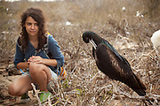 14 year old Isabel Durham observes a great frigatebird (Fregata minor) from the trail on Genovesa Island, Galapagos Archipelago - Ecuador. (fully released - 82010EXsP)