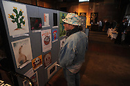 """Ron Shapiro looks at art during the Yoknapatawpha Arts Council's """"Art For Everyone"""" fundraiser in Oxford, Miss. on Tuesday, October 18, 2011."""