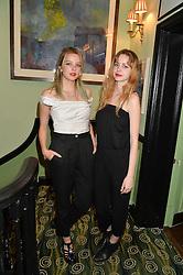 Left to right, sisters GRETA BELLAMACINA and COSIMA BELLAMACINA at a Bastille Day Cocktail Party at L'Escargot, 48 Greek Street, London on 14th July 2014.