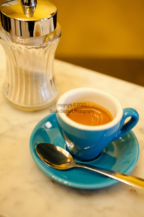 Spella Caffe, a tiny, Italian style coffee shop in downtown Portland, Oregon specializes in traditional espresso and espresso drinks using their own roasted coffee beans.  Pictured here is a classic single shot of espresso with the signature crema in a lovely blue traditionally shaped espresso cup.