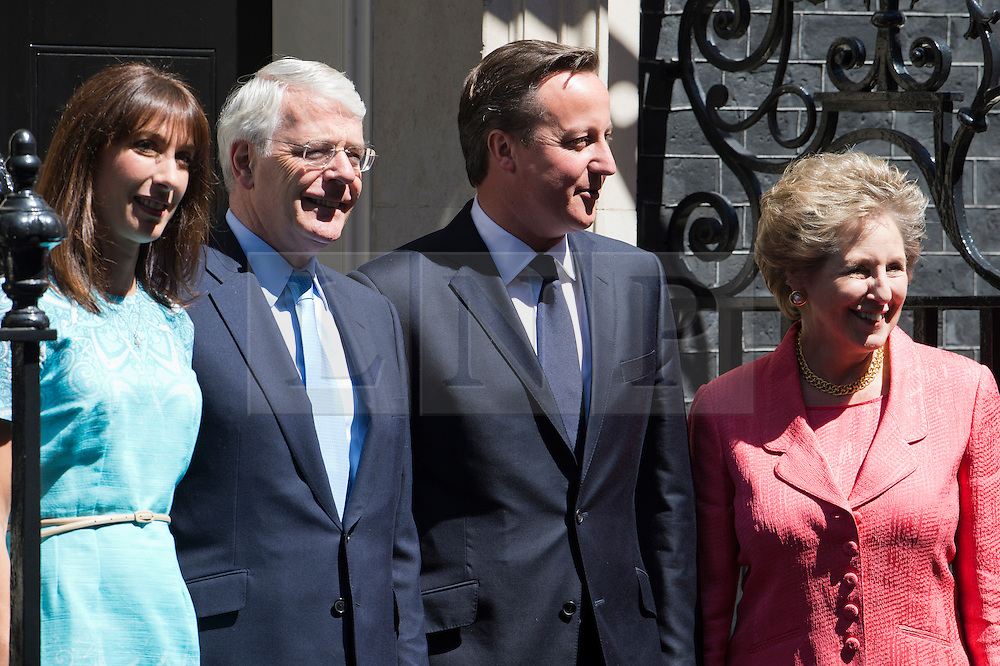© London News Pictures. 25/07/2012. London, UK. L to R SAMANTHA CAMERON, Former British Prime Minister JOHN MAJOR, Prime Minister DAVID CAMERON and MORMA MAJOR on the steps at 10 Downing street before a lunch with Prime Minister David Cameron on July 24, 2012. Photo credit: Ben Cawthra/LNP.