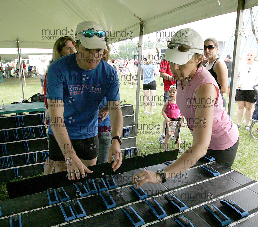 (Ottawa, Canada---19 June 2010) The Sportstats.ca timing chips being handed out at competitors at the 2010 edition of Emilie's Run - The Emilie Mondor Memorial 5K Race for Women. Photograph copyright Sean Burges / Mundo Sport Images, 2010.