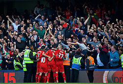 LONDON, ENGLAND - Saturday, October 31, 2015: Liverpool's Christian Benteke celebrates with team-mates and supporters after scoring the third goal against Chelsea during the Premier League match at Stamford Bridge. (Pic by Lexie Lin/Propaganda)