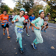 NYTRUN - NOV. 6, 2016 - NEW YORK - Two runners dressed as Lady Liberty, smile for a photo as they head south on East Drive in Central Park during the 2016 TCS New York City Marathon on Sunday afternoon. NYTCREDIT:  Karsten Moran for The New York Times