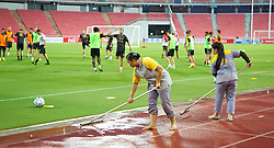BANGKOK, THAILAND - Saturday, July 27, 2013: Staff brush water away after a downpour of rain before a training session for Liverpool players at the Rajamangala National Stadium ahead of their preseason friendly match against Thailand. (Pic by David Rawcliffe/Propaganda)