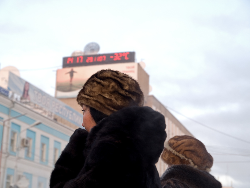 Two women protected with the traditional fur cap and warm clothing against the extrem cold. Yakutsk is a city in the Russian Far East, located about 4 degrees (450 km) below the Arctic Circle. It is the capital of the Sakha (Yakutia) Republic (formerly the Yakut Autonomous Soviet Socialist Republic), Russia and a major port on the Lena River. Yakutsk is one of the coldest cities on earth, with winter temperatures averaging -40.9 degrees Celsius.