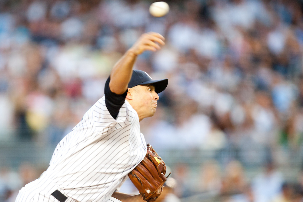 NEW YORK - JUNE 30: Javier Vazquez #31 of the New York Yankees pitches against the Seattle Mariners at Yankee Stadium on June 30, 2010 in the Bronx borough of Manhattan. The Mariners defeated the Yankees 7 to 0. (Photo by Rob Tringali) *** Local Caption *** Javier Vazquez