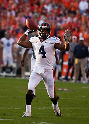 November 21, 2009; Clemson, SC, USA;  Virginia Cavaliers wide receiver Vic Hall (4) throws a touchdown pass during the second quarter against the Clemson Tigers at Memorial Stadium.  Clemson defeated Virginia 34-21.