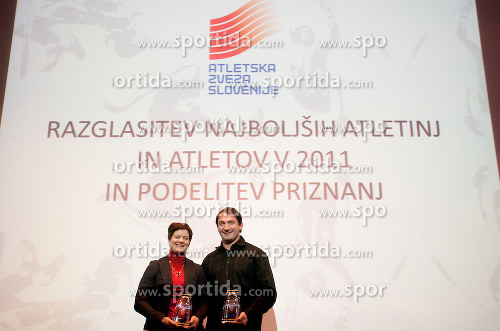 Best of 2011 Martina Ratej and Primoz Kozmus during the Slovenia's Athlete of the year award ceremony by Slovenian Athletics Federation AZS, on November 11, 2011 in Hotel Mons, Ljubljana, Slovenia. (Photo By Vid Ponikvar / Sportida.com)