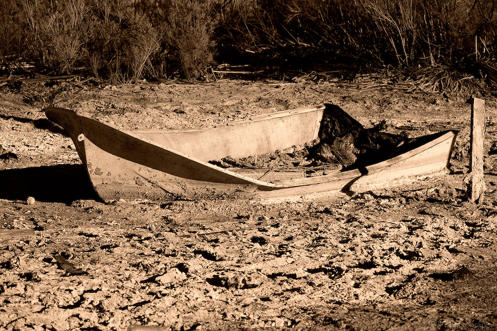 Leftover boat remains sinking in to the mud at Bombay Beach, CA along the shores of the Salton Sea.