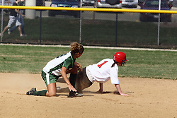 05 April 2008: Allison Ward tags Meghan Roman at 2nd base. The Carthage College Lady Reds lost the first game of this double header to the Titans of Illinois Wesleyan 4-1 at Illinois Wesleyan in Bloomington, IL