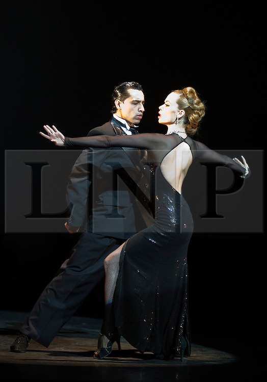 """© Licensed to London News Pictures. 30/01/2013. London, England. Scene: Gallo Ciego danced by Marcos Esteban Roberts and Louise Junqueira Malucelli. The show """"FLAMES OF DESIRE"""" by the Argentine dance company """"TANGO FIRE"""" opens at the Peacock Theatre, London for a run to 24 February 2013. Photo credit: Bettina Strenske/LNP"""