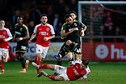 Wimbledon midfielder Andy Barcham (17) is fouled by Fleetwood Town forward Wes Burns (7)   during the The FA Cup 3rd round match between Fleetwood Town and AFC Wimbledon at the Highbury Stadium, Fleetwood, England on 5 January 2019.