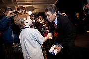 Republican presidential candidate Gov. Rick Perry talks to 7-year-old Catcher Jones aboard the USS Yorktown museum on December 8, 2011 in Mt Pleasant, South Carolina.