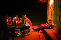 Medellin, Colombia- March 15, 2015: A group of friends enjoy a drink at Mahallo, a sports bar that overlooks the Aburrá Valley. CREDIT: Chris Carmichael for The New York Times