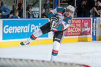 KELOWNA, CANADA - DECEMBER 27: Mitchell Wheaton #6 of the Kelowna Rockets takes a shot during warm up against the Kamloops Blazers on December 27, 2013 at Prospera Place in Kelowna, British Columbia, Canada.   (Photo by Marissa Baecker/Shoot the Breeze)  ***  Local Caption  ***