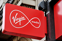 File photo dated 06/01/16 of a shop sign for Virgin Media in central London, Ofcom has opened a formal investigation into the fairness of Virgin Media's early termination charges on contracts for its broadband, phone and television services.