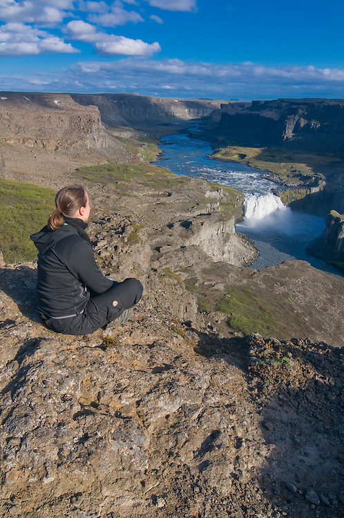 Touristin admiring  gorges, Jökulsárglijúfur National Park. Iceland.