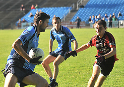 Westport's Mark McCaffrey tries to get past Swinford's Kevin McDonagh during the junior B final replay at McHale Park in Castlebar.<br /> Pic Conor McKeown