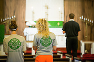 The Rev. Adam DeGroot leads morning worship during the 2014 Youth Corps pilot project at Shepherd of the City Lutheran Church on Tuesday, August 12, 2014, in Philadelphia, Pa. Standing are Kalli Parauka (left) and Talitha Elbert. LCMS Communications/Erik M. Lunsford