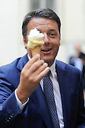Italian Prime Minister Matteo Renzi with an ice cream in the courtyard of Chigi building ironizes against The Economist magazine's cover.<br /> &copy;Giuseppe Giglia